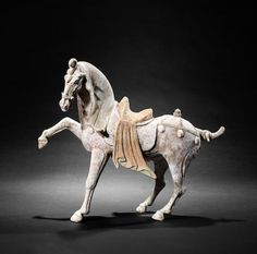 A large painted pottery model of a prancing horse Tang Dynasty. 唐 陶胎彩繪馬俑