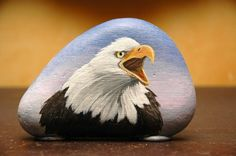 Amazing bald eagle acrylic painting on rock by artist Ron Clifford.  Image from RonClifford.com. Rock art