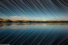 Variant A was taken by Dugio Otok and shows a captivating star trail over a lake in Croatia French Lavender Fields, Comets And Asteroids, Angel Flight, Star Trails, Light Pollution, Magic City, Like Image, Stonehenge