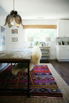 Layered rug envy- could replicate this look with a Mexican blanket or fabric on top