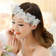 Simple and stylish wedding hairstyle with flower headband