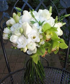 Bridal bouquet of green cymbidium orchids, white roses and freesia. Orchid Bridal Bouquets, Wedding Bouquets, White Bouquets, Green Orchid, Rose Centerpieces, Green Palette, Cymbidium Orchids, White Wedding Flowers, Wedding Designs