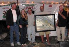 Capt. Mark Krowka, left, and Mo Smith, with a Tim Borski original painting, won a prior Redbone. The 2013 Redbone Tournament is set for Nov. 1-3 in Islamorada. Call 305-644-2002 to get involved.