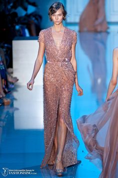 Scattered with beads like silver dew drops or swishing with deep blue embellished tulle like a sky at midnight; each gown of Elie Saab's fall 2011 haute couture collection brought with it a certain...