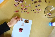 Otis making 'faces' from magazine cut outs Winter School Holidays July 2015