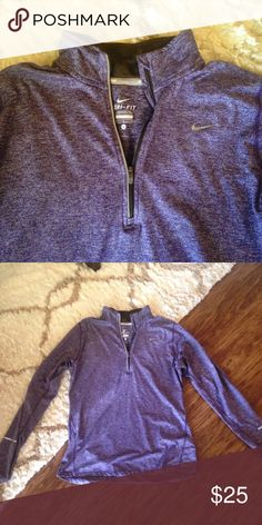 NIKE Element Dri-Fit Half Zip Running Top Purple Nike pullover perfect for running. Keeps you super warm in winter. Has thumb holes at the bottom of sleeves. Stretchy polyester/spandex blend. Nike Tops