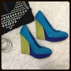 Bold and Colorful Heels These colorblock heels are perfect for any party occasion or night out! They are bright green with two shades of blue. The heels are 5 inches. They are like new with the sticker still on the bottom but no other tags. Charlotte Russe Shoes Heels