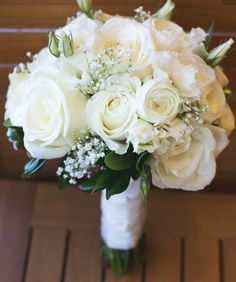 A romantic bouquet with ivory roses and white gypsophilia #bridalbouquet #weddingingreece #mythosweddings
