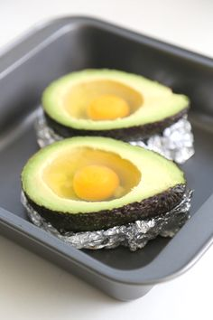 BAKED EGGS IN AVOCADO // Preheat oven to 475. Cute avocado in half and drop one egg into each. Bake for 15-20 minutes or until egg turns white and becomes firm.