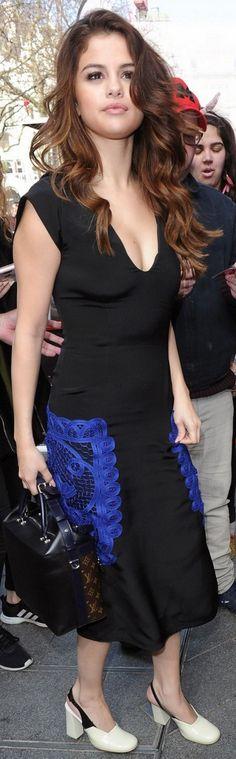 Who made  Selena Gomez's brown print handbag and black dress?