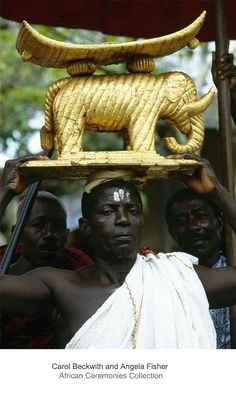 Africa | An attendant carries a golden elephant stool during the Ashanti jubilee celebrations. 25th anniversary jubilee celebrations of Ghana's Asantehene, Opoku Ware II, Kumase, Ghana | ©Carol Beckwith and Angela Fisher