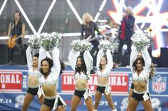 [Oakland Raiderettes] Cheerleaders perform before an NFL football game between the Miami Dolphins and the Oakland Raiders, Sunday, Sept. 28, 2014, at Wembley Stadium in London. (AP Photo/Lefteris Pitarakis)