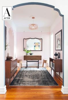 Before & After: A Small Brooklyn Apartment Gets a Makeover | The apartment has three main spaces — an open foyer, a large room that needed to be her living room, bedroom and office rolled into one and a tiny kitchen she wanted to modernize. Let's see how she tackled each of these spaces to suit her needs and her style.