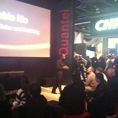 Danny Peters introduces Quantel's Pablo Rio to attendees at their booth in the South Hall (SL02109)