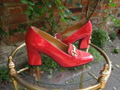 """STUDIO GARDENIA Made in Italy. Vivid red patent, metallic sheen, with red suede vamp; gilt 'G-bit' at vamp; 3"""" heels, leather soles, minimal wear. Size 37 ½ / 4 ½ / 7."""