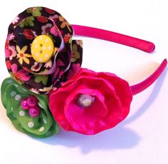 Headband with Three Ribbon Flowers in Pink, Green Polkadot, and Chocolate Brown Floral Pattern. $12.00, via Etsy.