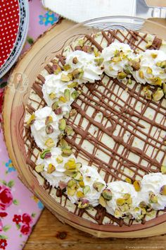 A Delicious and Creamy No-Bake White Chocolate Pistachio Cheesecake! Perfect *non*bake for Chocolate, Nut & Cheesecake lovers! I have obviously always been a Cheesecake fiend and that's no lie… I'm commonly know as the 'Queen of Cheesecakes' these days between my friends and some of my followers, so I simply had to post this one. As one of the first recipes on my blog was pistachio based cheesecake, I had to repost it as something spectacular with a method that makes sense, and some damn…