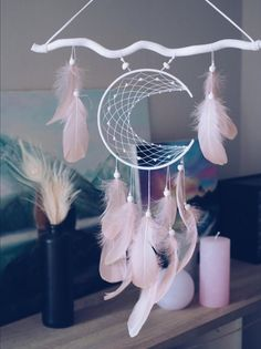 Moon dream catcher Wall hanging Room decor Dream catcher featuring a moon shaped frame with light pink tender feathers. You can choose the colour of the moon and stick, just contact me) Dream Catcher Decor, Dream Catchers, Dream Catcher Mobile, Dream Catcher Pink, Feather Dream Catcher, Craft Stick Crafts, Diy And Crafts, Moon Dreamcatcher, Creation Deco