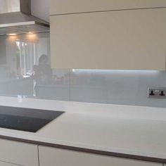 Light Grey Glass Kitchen Splashback by CreoGlass Design (London,UK). View more toughened glass splahback designs and non-scratch worktops on www.creoglass.co.uk #kitchen #backsplash