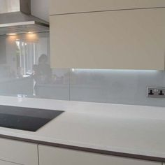 Light Grey Glass Kitchen Splashback by CreoGlass Design (London,UK). View more toughened glass splahback designs and non-scratch worktops on www.creoglass.co.uk #kitchen #backsplash