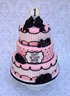 Pink and black French themed bow cake. All fondant, three tiers.