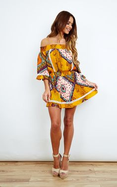This chic boho mini dress is the perfect festival outfit. With its off the shoulder style and colourful bohemian print, this little number is guaranteed to turn heads all summer. Shop Now