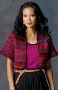 Free crochet pattern. Pattern category: Shrugs. Worsted weight yarn. 900-1200 yards. Features: Seamless, Top-Down. Intermediate difficulty level.