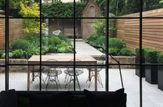 Robert Budwig Landscape and Garden Design featuring Stone Age Stone. Pietra Laro Grey, a robust limestone with subtle markings. Great inside or outside
