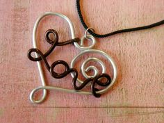 Loving Heart Necklace - Anodized Aluminum Wire - Choose Your Color. $18.00, via Etsy.