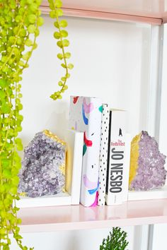 Sure, crystals have healing powers... healing a bland, boring bookshelf by adding a bold pop...