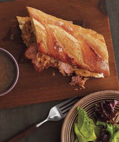 Slow Cooker French Dip Sandwich: Simmer the brisket in beef broth seasoned with onion, garlic, and Worcestershire sauce for tender, juicy results. Get the recipe for French Dip Sandwich.