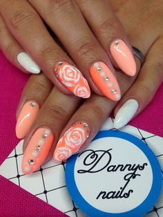 Orange nails with roses