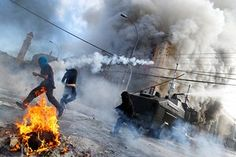 Anti-government demonstrators and riot police clash during a rally, as Chile's President Michelle Bachelet delivers a speech inside the National Congress, in Valparaiso city, Chile . Riot Police, Refugee Crisis, South Of The Border, Photos Of The Week, Central America, May, Amazing Photography, Cool Photos, Around The Worlds