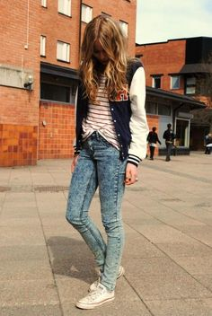 love this look. acid wash skinny jeans, striped tee, varsity jacket, down to the low top white chucks and the hair too. just perfect!