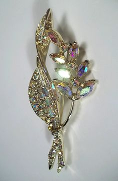 Vintage Signed PELL Silver Toned Aurora Borealis Iridescent Rhinestone Marquis Cut Leaf and Flower Brooch Pin.
