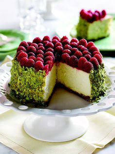 Can you imagine this on your holiday table? pistachio crusted cheesecake topped with fresh raspberries from My Mother's Apron Strings