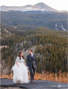 Bride and groom walk up the path at Lodge at Breckenridge for their sunset portraits during autumn in Colorado. - April O'Hare Photography http://www.apriloharephotography.com