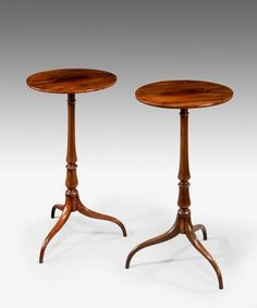 A pair of antique Sheraton rosewood tripod tables.