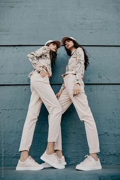 Two Women in Matching Pink Outfits by Rachel Gulotta Photography for Stocksy United
