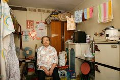 German photographer Michael Wolf takes 100 pictures of 100 Hong Kong homes which measure 100x100 square feet...
