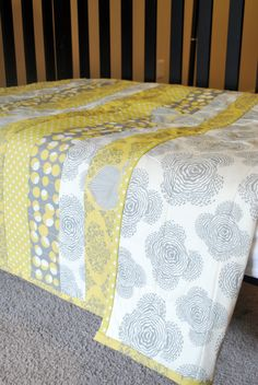 Yellow and Grey striped baby quilt by Jonna of the Fingers and Toes etsy shop.