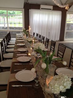 Farm tables, lace, mercury glass accents, hydrangeas, tulips, candlelight