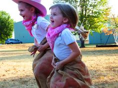 cowgirl party games... sack race, photo booth, pinata, and bean bag horseshoes!