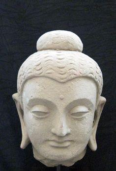 "Gandhara Stucco Head of the Buddha - RP.169 Origin: Afghanistan/Pakistan Circa: 100 AD to 300 AD  Dimensions: 8.2"" (20.8cm) high x 5.75"" (14.6cm) wide  Collection: Asian Art Medium: Schist  £12,500.00"