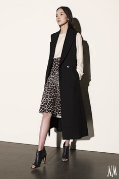 Three must-have pieces by Theory create one stylish statement. Pair this menswear-inspired sleeveless coat with an ultra-feminine blouse and skirt for a modern take on workwear.