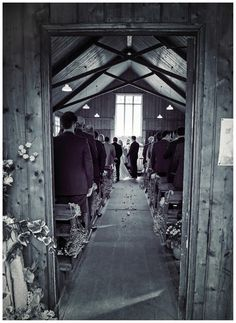 A wedding blessing in the Mission Church at Avoncroft Museum of Historic Buildings (avoncroft.org.uk). Black and white photograph. Rosie Kelly Photography