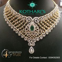 Amazing diamond necklace design with a huge tear shaped emerald in the center.