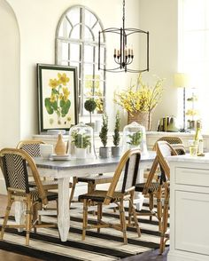 This sunny dining area is open and happy, thanks to a few pops of cheery yellow