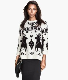 The perfect piece for holiday parties and winter lounging. Black & white sweater in wool blend, with jacquard-knit winter pattern, 3/4 sleeves, and side slits.   Warm in H&M