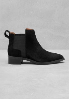 Crafted from soft suede, these boots feature a comfy ankle height with elastic panels.